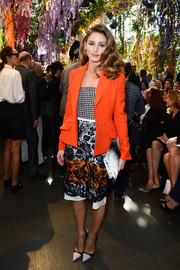 Olivia Palermo added rich color to her ensemble with a chic orange blazer when she attended the Christian Dior fashion show.