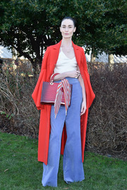 Erin O'Connor topped off her vibrant ensemble with a red coat, also by Dior Couture.