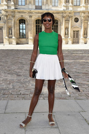 Shala Monroque completed her outfit with a shiny black box clutch.