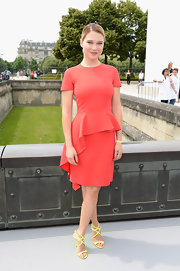 Lea Seydoux chose this capped-sleeve red dress that featured a cascading peplum for her look at the Christian Dior Haute Couture show.