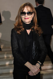 Isabelle Huppert was low-key but elegant in a textured black button-down shirt at the Christian Dior fashion show.