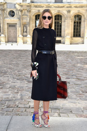 For a splash of color to her black outfit, Olivia Palermo donned a pair of tasseled sandals by Jimmy Choo.