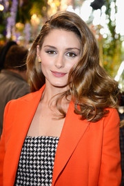 Olivia Palermo looked breathtaking at the Christian Dior fashion show with her voluminous curls.