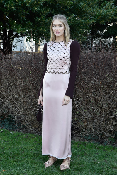 Elena Perminova kept it demure at the Dior Couture show in a pale-pink satin dress with a lattice bodice and contrast sleeves.