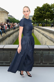 Leelee Sobieski rocked a capped-sleeve dark blue denim jumpsuit at the Christian Dior Haute Couture fashion show.