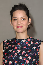 Marion Cotillard wore her dark curls in a sweet ponytail for the Dior Couture show in Paris.
