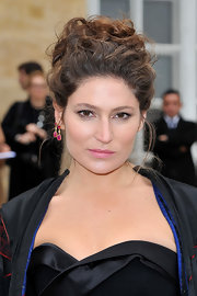 Stella Schnable looked high fashion as she wore two dangle earrings in one ear at the Christian Dior fashion show.