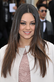 Mila Kunis arrived for the Christian Dior fall 2012 runway show wearing her ultra-shiny locks long and straight.