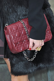 Olivia Palermo carried this maroon quilted bag with a heavy chain strap to the Christian Dior show in Paris.