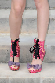 Roxanne sported a bold pair of lace-up, cutout, boots with sweet polka-dotted bow details.