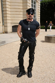 Peter paired his leather pants and matching cap with combat boots.