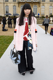 Susie Lau was hippie-glam in a pink fur coat layered over a print shirt during the Dior Couture show.