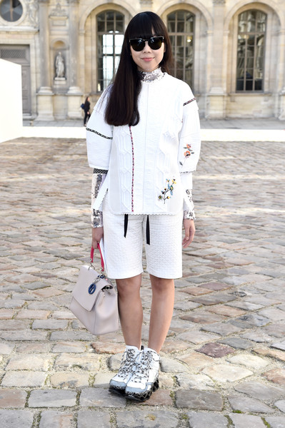 Susie Lau layered  a loose white Christian Dior top over a sequined turtleneck for the label's fashion show.