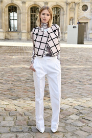 Elena Perminova capped off her outfit with a pair of white slacks, also by Dior.
