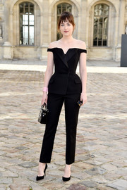 Dakota Johnson suited up in sexy-chic style with this tux-inspired black off-the-shoulder number by Christian Dior for the label's fashion show.