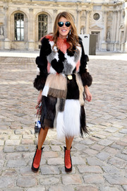 Anna dello Russo was her usual bold self in a patchwork fur coat during the Christian Dior fashion show.