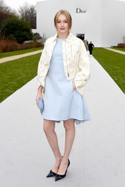 Maddison Brown looked fresh and sweet wearing a mini dress in a cool pastel-blue hue during the Dior Couture show.