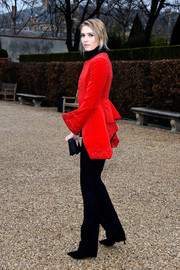 Wearing a red tailcoat, Elena Perminova looked like she just stepped out of a period movie when she attended the Dior Couture show.