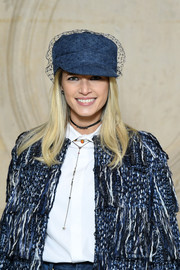 Helena Bordon attended the Dior Fall 2018 show wearing a denim and fishnet newsboy cap from the brand.