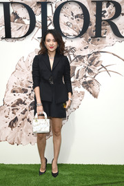 Zhang Ziyi suited up summer style in this black jacket and shorts combo for the Christian Dior Haute Couture show.