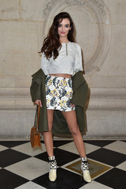 Charlotte Le Bon teamed her top with a floral mini skirt.