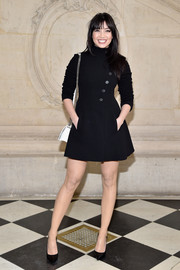 Daisy Lowe looked simply elegant in a little black coat dress by Dior while attending the label's fashion show.
