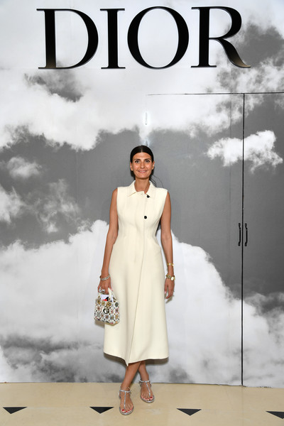 Giovanna Battaglia styled her frock with a pair of silver thong sandals.