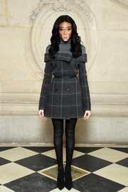 Winnie Harlow donned a pair of dotted black tights for added warmth.