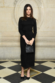 Julia Restoin-Roitfeld complemented her top with a black suede pencil skirt.