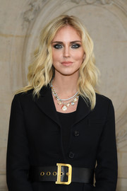 Chiara Ferragni adorned her outfit with a gold charm necklace.