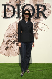 Caroline Issa teamed boyfriend jeans with a double-breasted blazer and printed boots for the Christian Dior Haute Couture show.