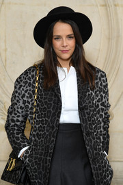 Pauline Ducruet accessorized with a leopard-print shoulder bag to match her jacket at the Dior Fall 2018 show.