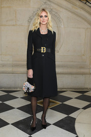 Chiara Ferragni complemented her coat with black slingback pumps by Dior.