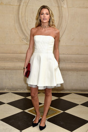 Helena Bordon looked ultra girly in a strapless white leather dress by Dior during the label's fashion show.
