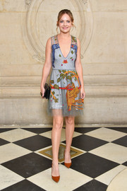 Britt Robertson looked picture-perfect in a colorful embroidered mini dress by Dior during the label's Spring 2018 show.