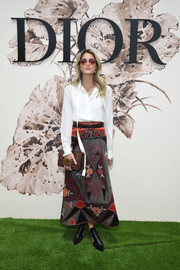 Helena Bordon rounded out her look with a brown snakeskin clutch, also by Dior.