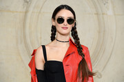 Charlotte Le Bon accessorized with a black choker adorned with multicolored studs.