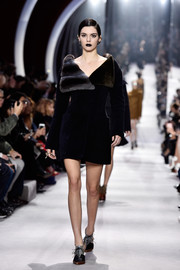 Kendall Jenner modeled this ultra-luxe fur coat at the Christian Dior fashion show.