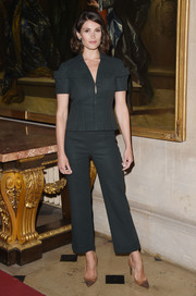 Gemma Arterton was tough-chic at the Christian Dior Cruise show in a cropped dark-ivy pantsuit with military pockets.