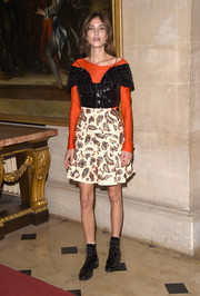 Alexa Chung amped up the rocker-glam feel with a pair of black patent combat boots.