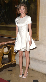Arizona Muse was demure and classy in a little white satin dress while attending the Christian Dior Cruise show.