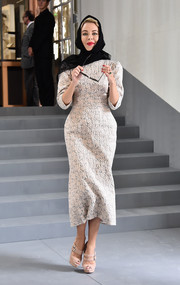 Ulyana Sergeenko exuded vintage elegance in this textured midi dress while attending the Dior fashion show.