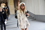 Anna dello Russo donned a beaded white coat dress by Christian Dior for the label's Spring 2017 show.