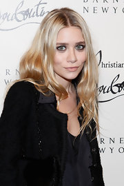 Ashley Olsen wore her wavy flaxen locks casually tousled at the Christian Louboutin cocktail party in Barneys New York.
