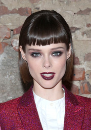 Coco Rocha wore her hair in a bob with Cleopatra bangs at the Christian Siriano Spring 2015 show.