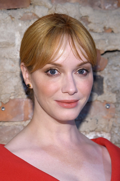 Christina Hendricks pulled her hair back into a chignon for the Christian Siriano fashion show.