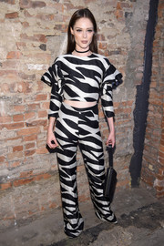 Coco Rocha stayed cool in a black-and-white crop-top with ruffle shoulders for the Christian Siriano fashion show.