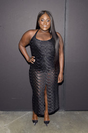 Danielle Brooks' curves were on full display in a sheer, body-con black dress at the Christian Siriano fashion show.