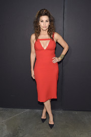 Gina Gershon sizzled in a cleavage-flaunting cutout dress at the Christian Siriano fashion show.