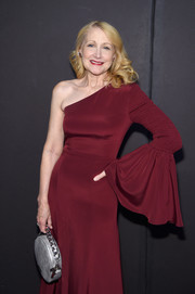 Patricia Clarkson paired a circular silver purse with a maroon one-sleeve dress for the Christian Siriano fashion show.
